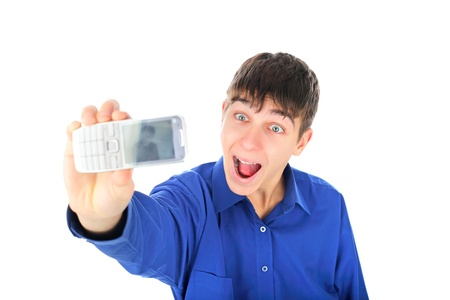 teenager gets ready to take a photograph with mobile phone photo