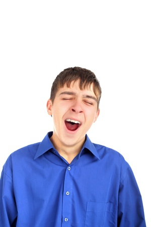 The yawning teenager isolated on the white photo