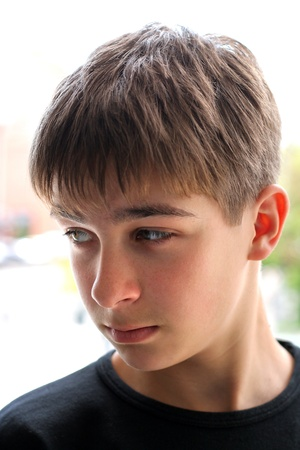 teen boy face: young teenager portrait close up