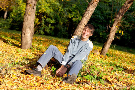 happy teenager in the autumn park photo