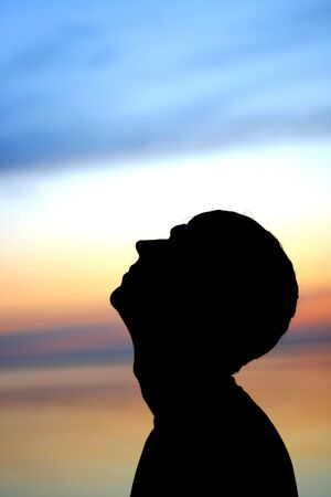 man silhouette on the sunset background Stock Photo - 9380156
