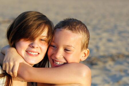 brother and sister on the evening beach Stock Photo - 9531249