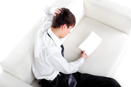 pensive teenager looking on the blank paper Stock Photo - 9531227