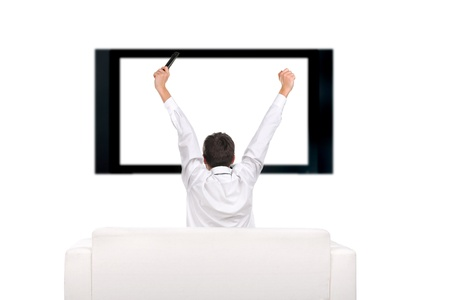 teenager with hands up watching tv-set photo