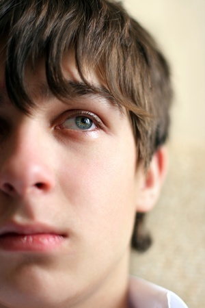 sad teenager portrait close up with focus on eye Stock Photo - 9872295