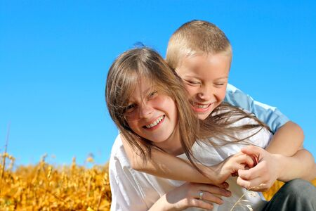 brother and sister in the summer field Stock Photo - 9872677