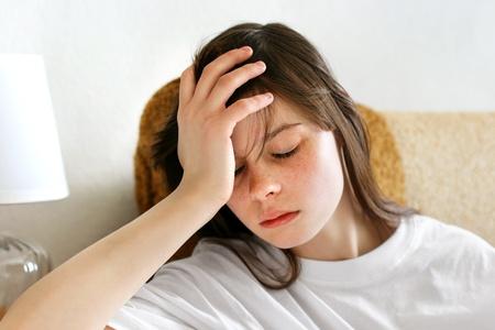 pitiful: sad teenage girl indoor interior Stock Photo