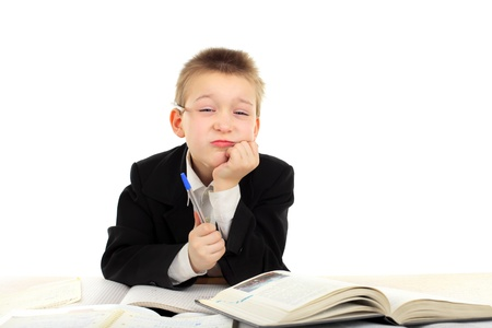 dissatisfied schoolboy on the table Stock Photo - 9872209
