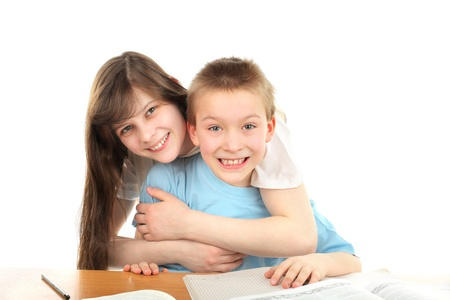 happy brother and sister on the table with exercise books Stock Photo - 9872184