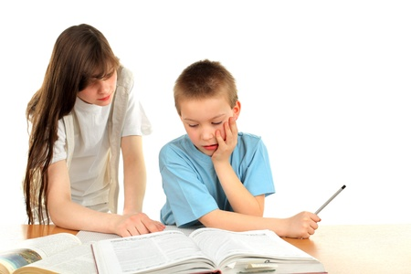 teenage girl and schoolboy on the table with exercise books Stock Photo - 9872675
