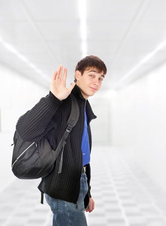 teenager wave goodbye in the white corridor photo