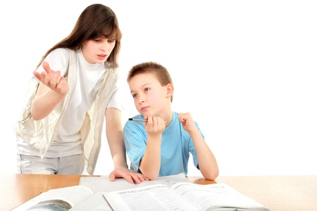 teenage girl and schoolboy on the table with exercise books photo