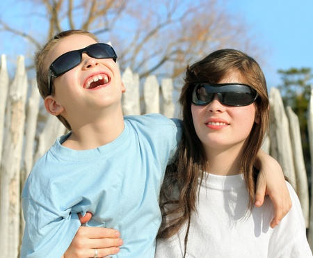 happy brother and sister in sun glasses outdoor photo