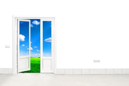 behind scenes: open door with sky and green field in the background