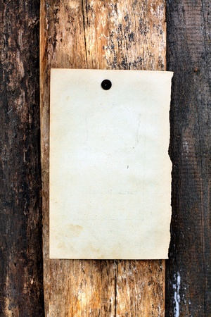 blank paper hanging on the wooden background photo