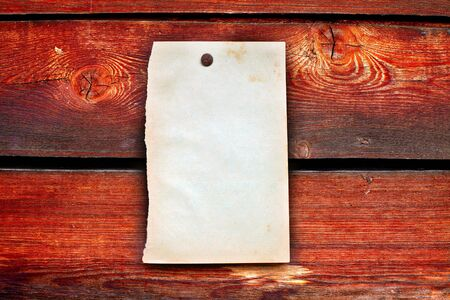 blank paper hanging on the wooden background Stock Photo - 10355153