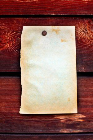 blank paper hanging on the wooden background Stock Photo - 10355145