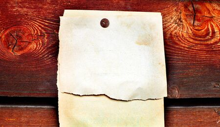 blank paper hanging on the wooden background Stock Photo - 10355144