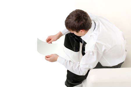 pensive teenager looking on the blank paper Stock Photo - 10355040