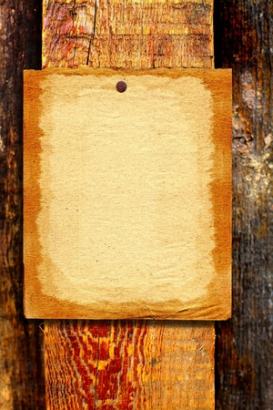 blank paper hanging on the wooden background Stock Photo - 10355140