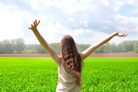 stretch out: happy teenage girl in the summer field Stock Photo