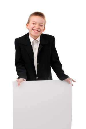 cheerful boy with blank broadsheet isolated on the white Stock Photo - 11221112