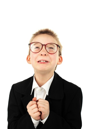 pardon: schoolboy in glasses begging pardon isolated on the white