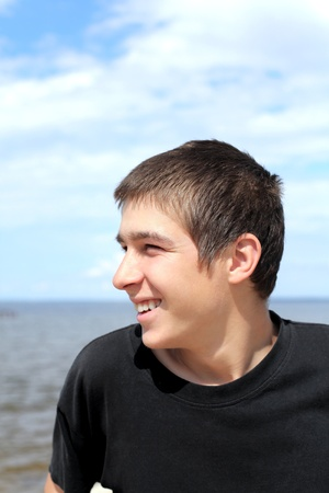 happy young man against seaside background Stock Photo - 11221130