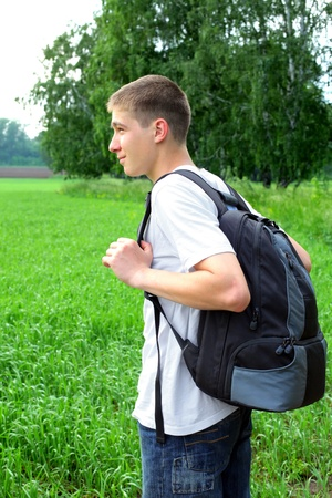 teenager with knapsack in the summer field Stock Photo - 11221160