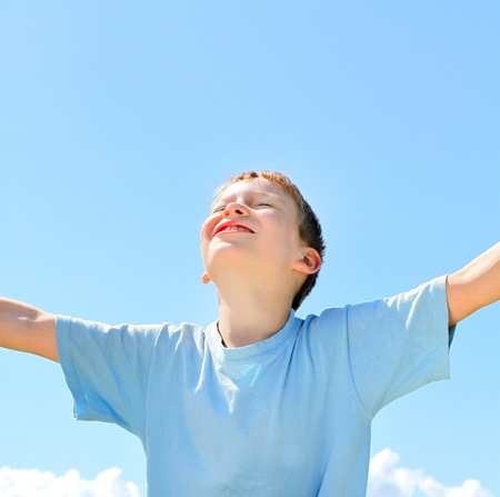 happy boy on the blue sky background Stock Photo
