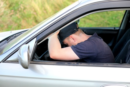 drowse: tired man fall asleep in a car
