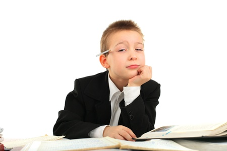 bored and tired schoolboy on the table Stock Photo - 12183660