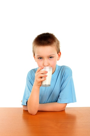 handsome blond boy with glass of milk isolated on the white background photo