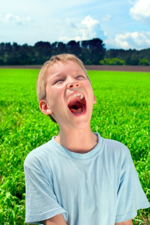portrait of screaming boy outdoor photo