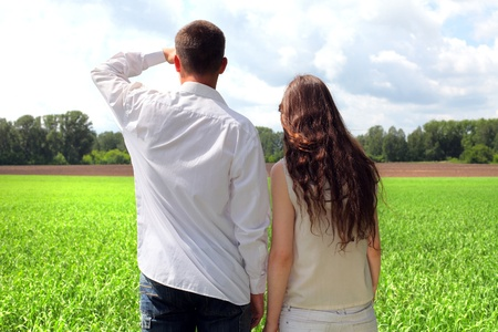 young man and teenage girl in the summer field Stock Photo - 12367255