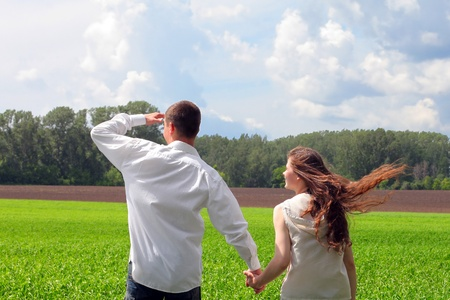 happy young man and teenage girl in the summer field Stock Photo - 12367256