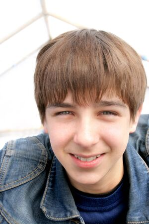 brown hair: smiling teenager portrait close up Stock Photo