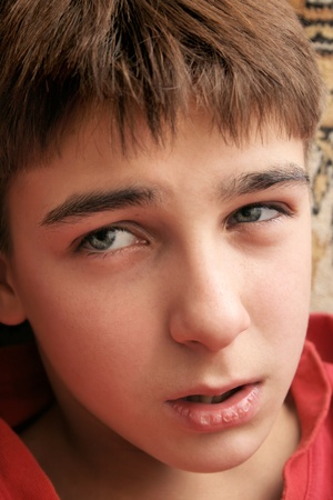 sad and confused teenager portrait close up photo