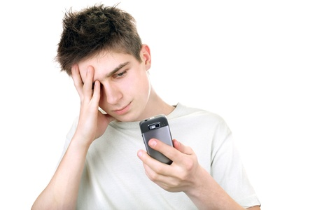 discontented young man looking on the mobile phone  isolated on the white