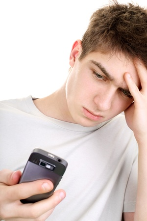misunderstanding: discontented young man looking on the mobile phone  isolated on the white