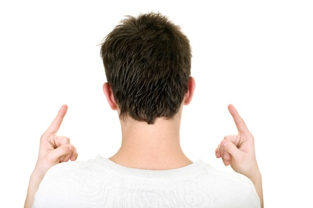 rear view of the young man with fingers up  isolated on the white background
