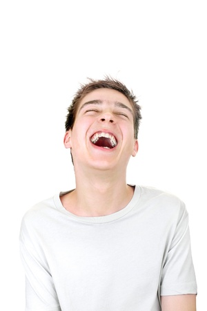 teenager is laughing isolated on the white background