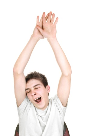 wearied: yawning teenager with hands up on the white background
