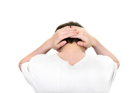 hands behind head: young man hands behind his head isolated on the white background
