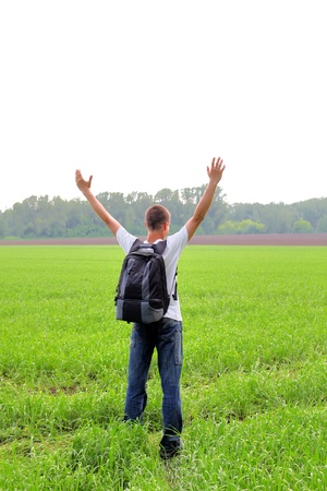 knapsack: happy teenager with knapsack in the summer field Stock Photo