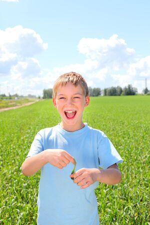 happy boy in the summer field photo