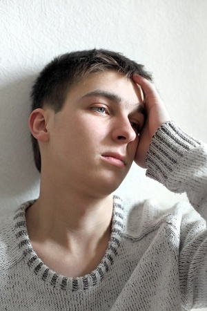 sad young man portrait in home photo