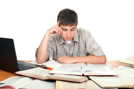 young male student working with many books on the table Stock Photo - 14657973