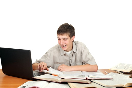 happy young male student working with notebook on the table Stock Photo - 14657969