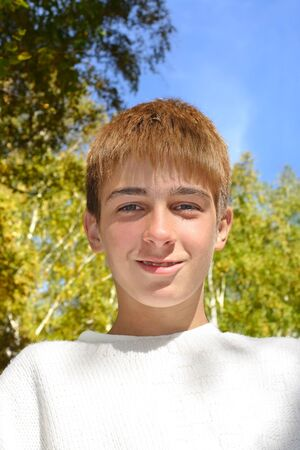 teenage boy portrait in the autumn park photo